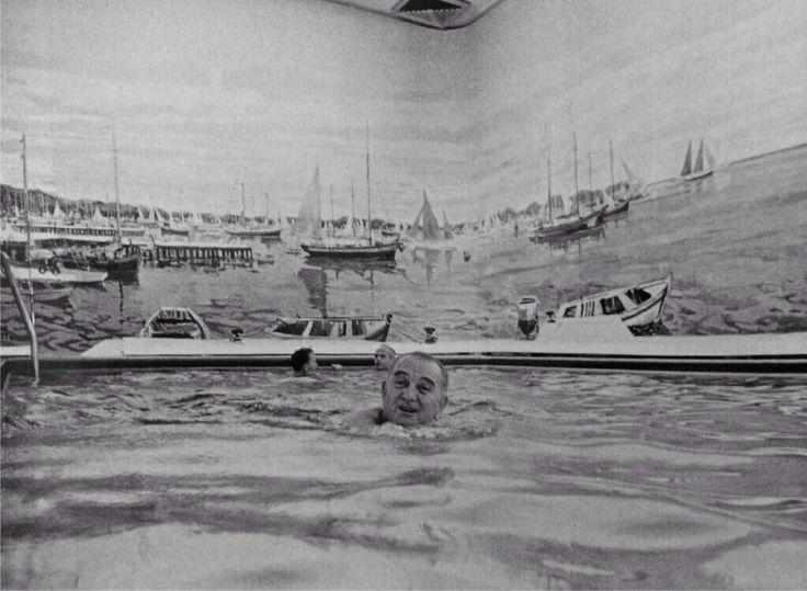 President Johnson swimming in the White House pool.