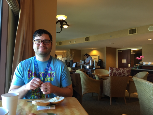 Kelly enjoying a bagel in the Club Lounge before we hit the parks.