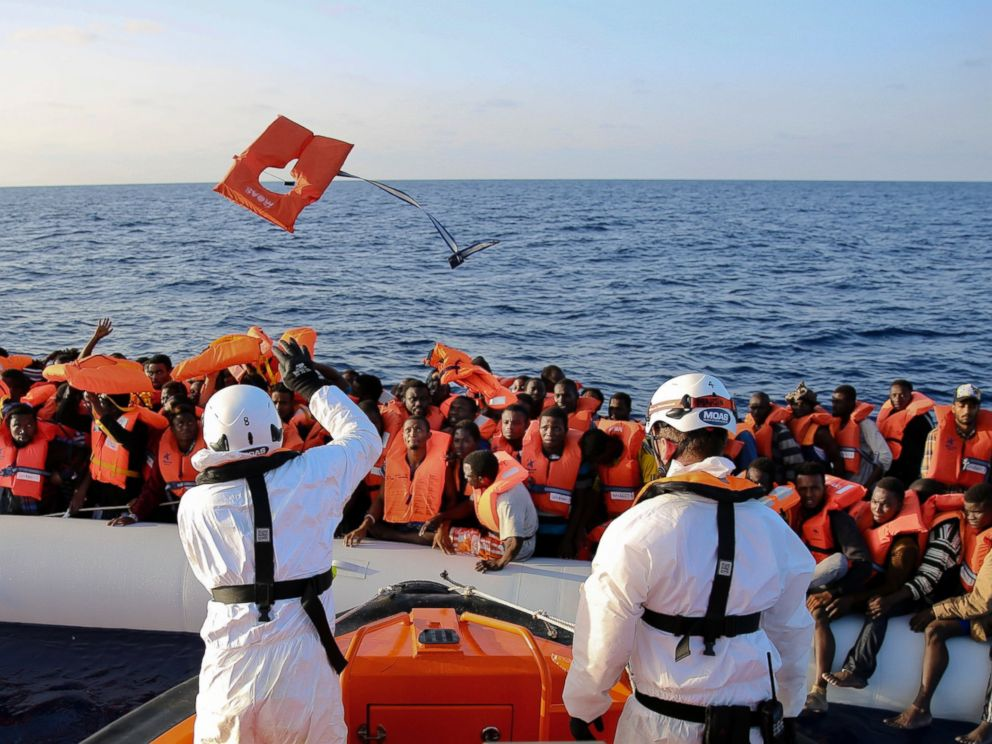 The Italian Red Cross intercepts a migrant vessel off the coast of Libya and proceeds to escort it to Italy.