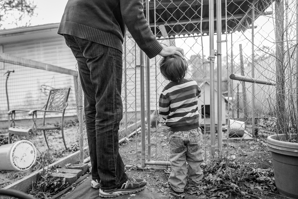 I love this image of my husband helping my son close up our chicken coop. I love that my little boy is becoming big enough to help with the chores and learning responsibility. The placement of my husband's hand on top of my son's head showing love and guidance melts my heart.