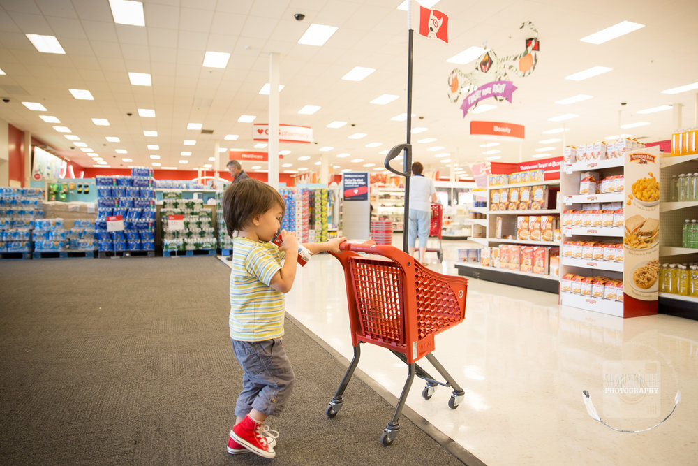 Chocolate milk in hand and off he goes. We love shopping at Target with the little red shopping carts.