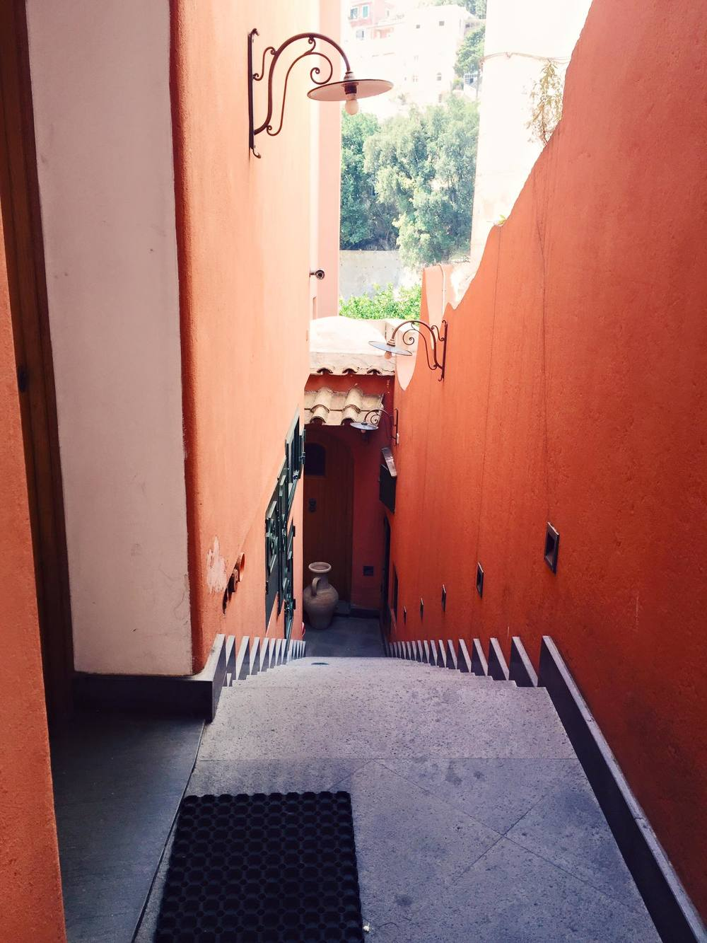 Coral-colored stairwell in Positano