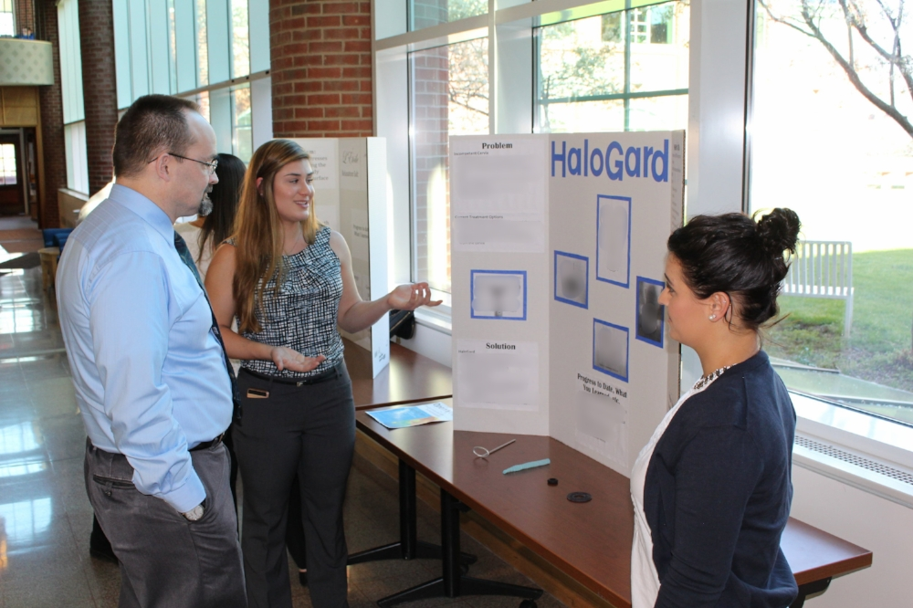 Interns presenting their projects at the Poster Session.