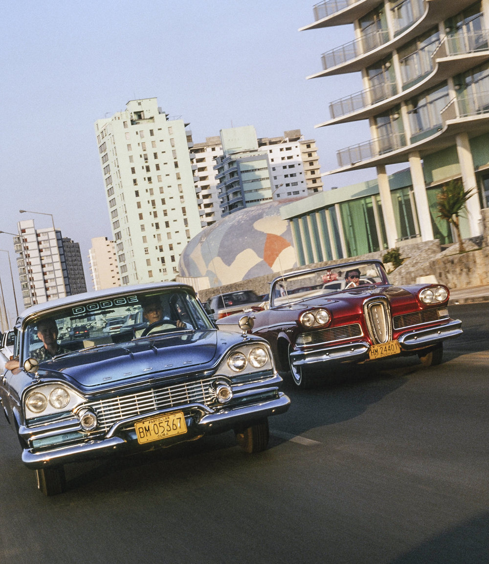 Dodge and Edsel passing the Riviera Hotel