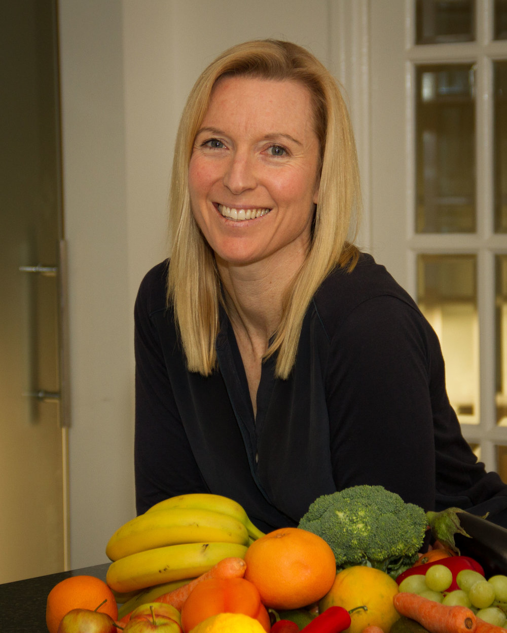 Debbie in her kitchen. (Credit to Luci Schofield Photography)