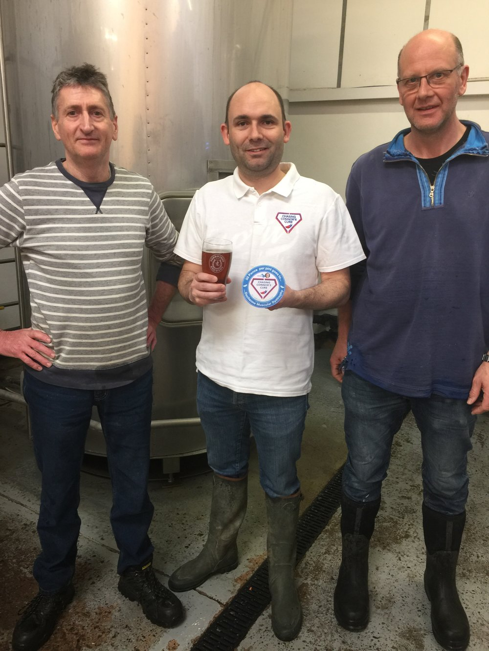 Matt Crawford, Connor's dad centre, with Paul Bournazian and Mark Gardner of Tonbridge Brewery