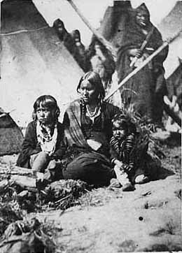 The wife of Indigenous leader Little Crow and their two children at Fort Snelling prison compound | Source: Minnesota Historical Society / Wikipedia