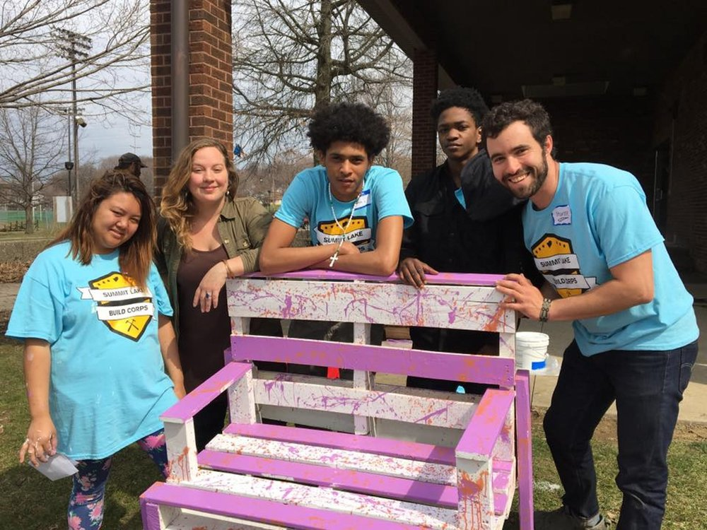 Members of the Summit Lake Build Corps pose with their finished bench. From left to right, Julie, League of Creative Interventionists fellow Megan Shane, Ramon, Markado, and League founder Hunter Franks.