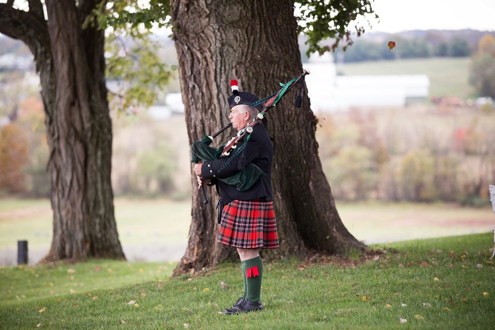 Bagpiper beneath tree.jpg