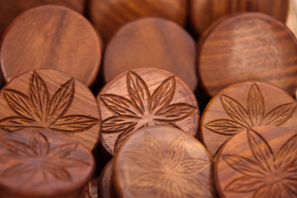 Wooden Marijuana stash boxes displayed for sale.