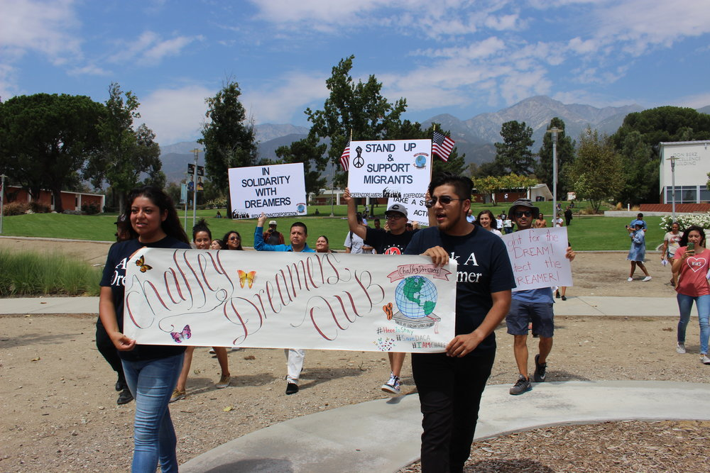 President and Vice President of the DREAMer Club, Moises Rosales Medina and Myra Ramirez Santiago, leading the march throughout campus. Photograph by Hector Solorzano.