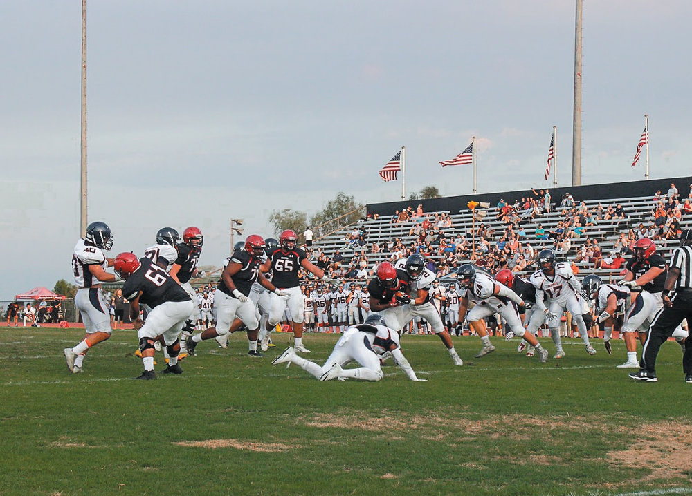 Ball-carrier Justin King picking up a first down just short of the end-zone on Sept. 2. Photo by Kyle Smith.