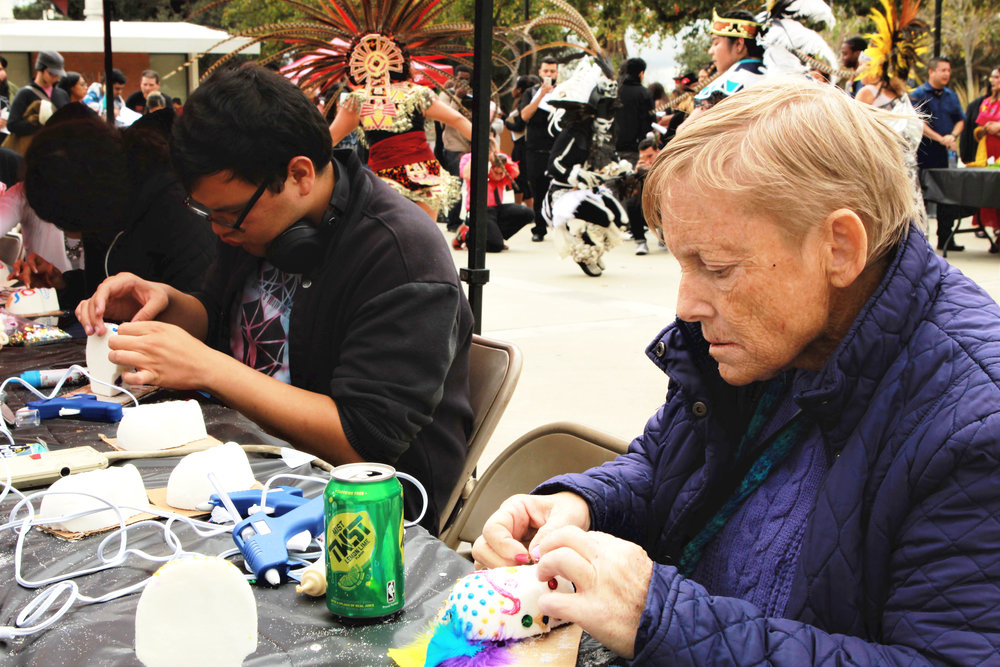 Debroh Dailey, a student of Chaffey College's Child Development Program, decorates her own sugar candy skull as part of the Day of the Dead festivities on Nov. 2, 2017. Photograph by Joshua Gutierrez.