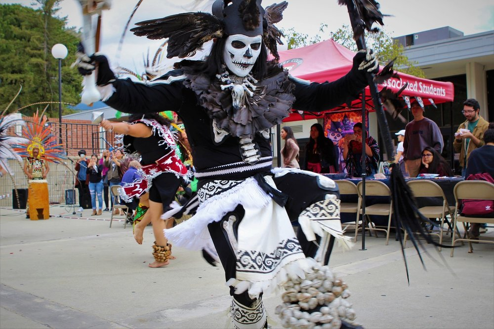 Eduardo Tzotzo, a member of the Danzantes del Sol, performs during the Day of the Dead celebration held at Chaffey College on November 2, 2017. Photograph by Joshua Gutierrez.
