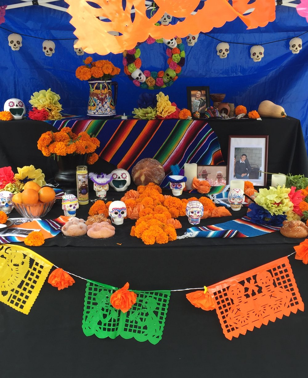 The shrine is a form of ancestor worship erected to pay homage to the dead. Dia de los Muertos (Day of the Dead) occurs every year, on November 2. Photograph by Christopher Salazar.
