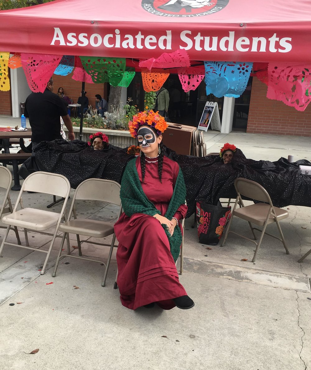 Stephanie Salas painted in the style of La Catrina, and student at The Academy of the Arts in El Sereno, attends the Chaffey College Day of the Dead event. Every year the Wignall Museum at Chaffey College has promoted The Day of the Dead event to highlight this Mexican celebration in honor of loved ones.