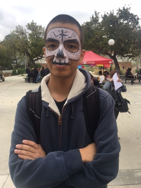 Dental assistant major, Eduardo Becerril's shows off his face paint during the Día De Los Muertos event on Chaffey's Rancho Cucamonga campus. The calavera face painting is a traditional aspect of the Día De Los Muertos event in Mexico.
