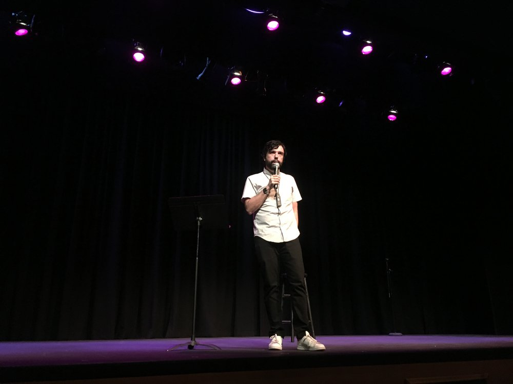 Comedian Chris Garcia tells a joke to the audience. Photo by Anissa Campa.