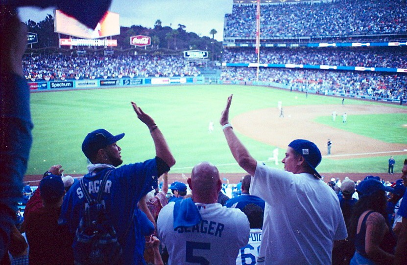 Two Dodger fans high-five each other during game () of the World Series.