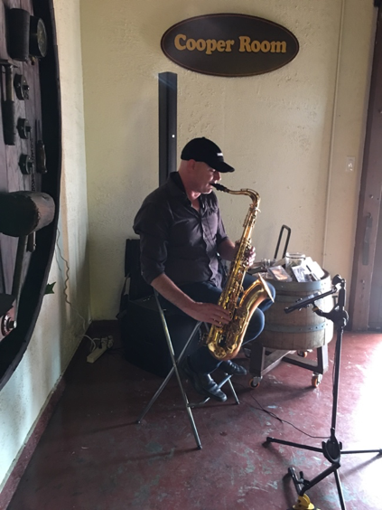 Jason Weber playing the saxophone at the Mountain View Winery. Photo by Sabino Villanueva.