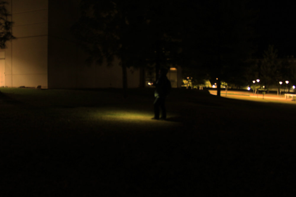 Even with a flashlight this student struggles to beat a path through the dark pocket in Cal state San Bernardino