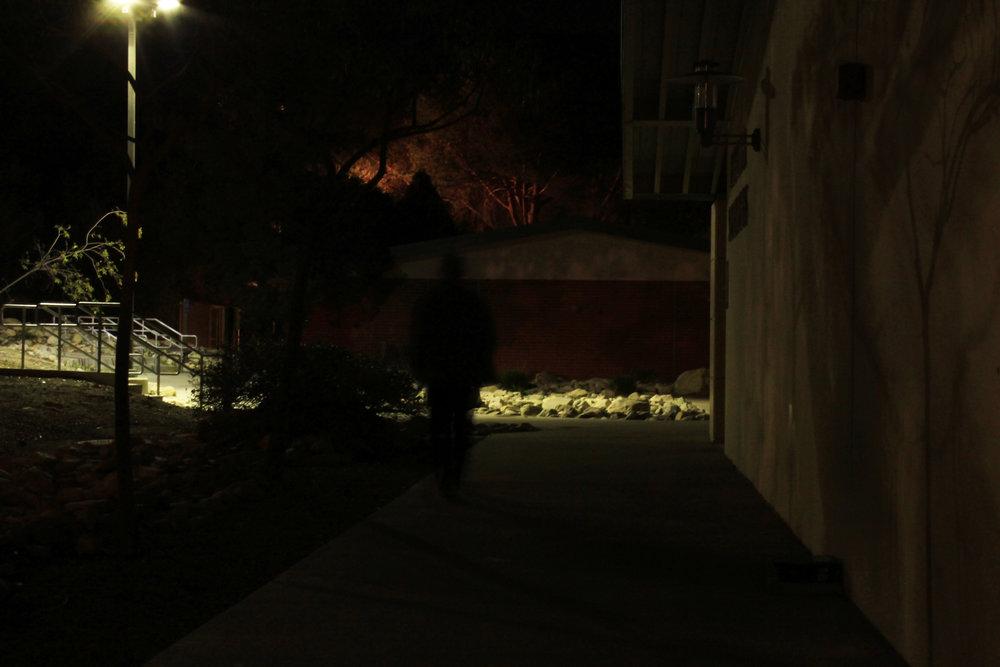 A dark figure walks through the shadows at Chaffey College.