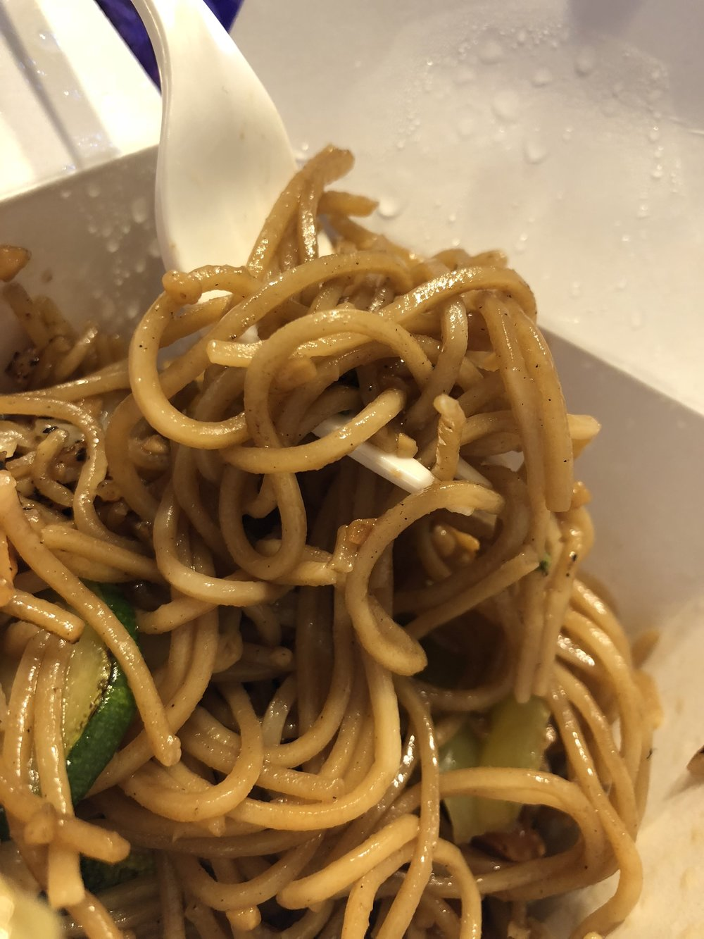 "rom the Loving Hunt on a take out box the ""Garden Chowmein."" Noodles cooked with carrots, cabbage, zucchini, and green bell peppers mixed with soy sauce."