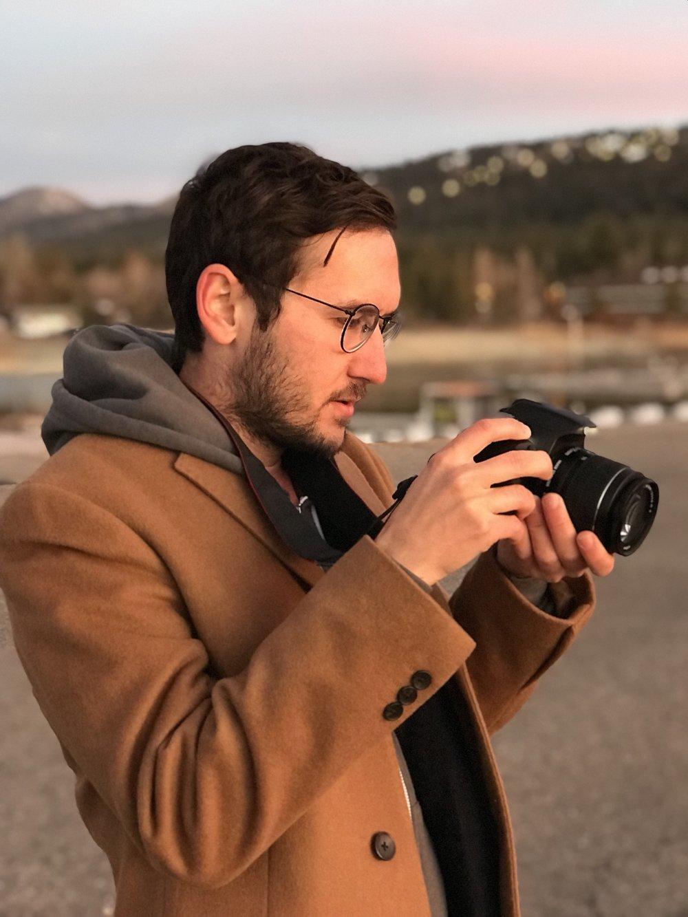 Accounting student Eli Bokori enjoying one of his passions, photography. Photo by Kris Tashjian