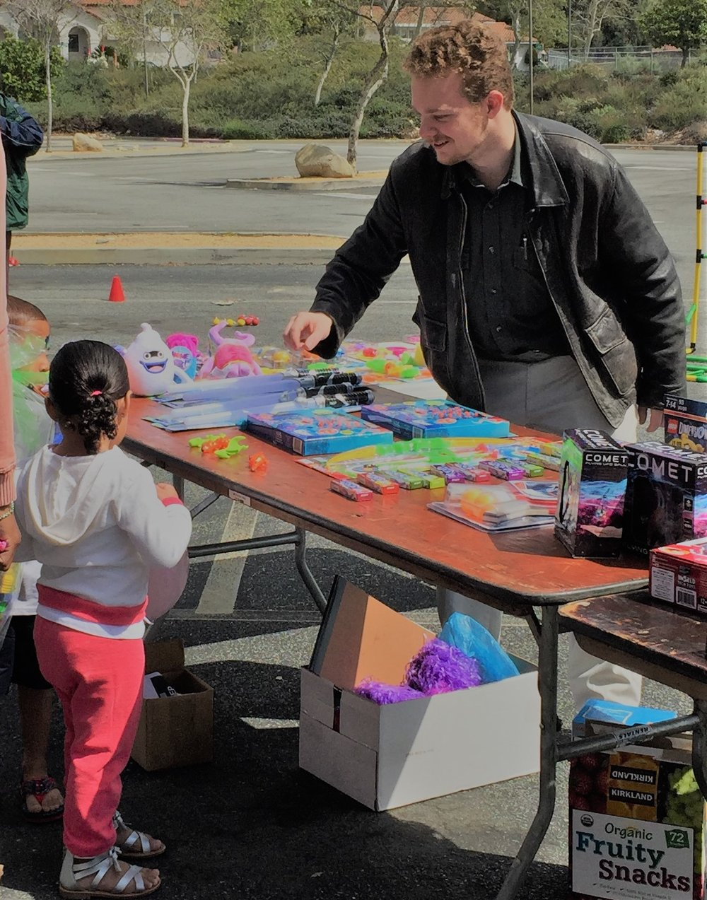 A volunteer handing out free toys for the kids