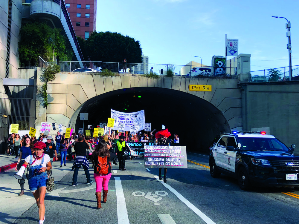 Protesters marching out of tunnel in DTLA