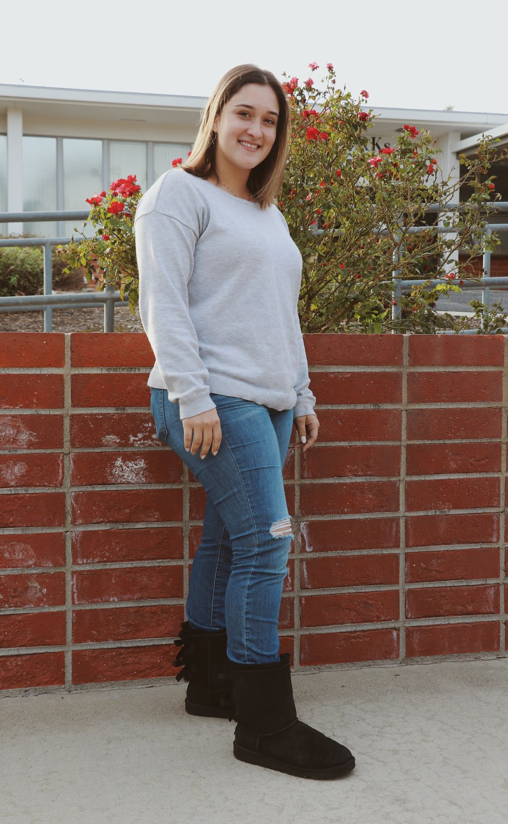 Chaffey student Emma Donnelly displays the epitome of casual comfort in a relaxed sweater, slightly distressed jeans and comfortable soft black boots.