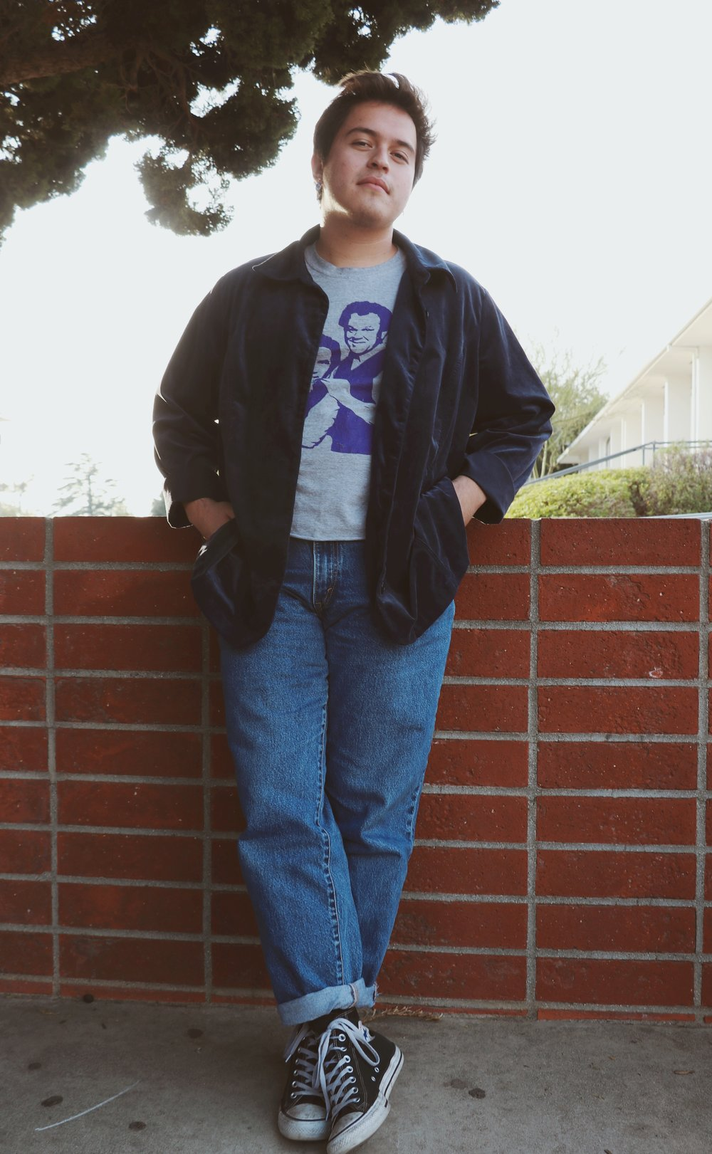 Chaffey student Hector Solorzano dresses casual in cuffed Levi jeans and a graphic tee, accessorized with Converse and a suede blazer, adding a chic twist.