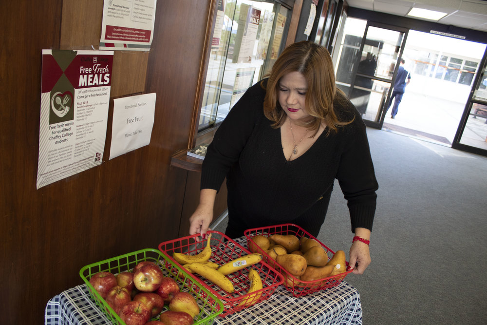 Lorena Corona putting out fresh food for students next to the Center for Cultural and Social Justice. All photos by Daniela Fabian.