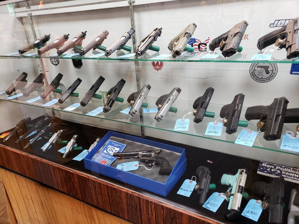 The variety of pistols for sale in a pawn shop. Photo by Erick Chairez.