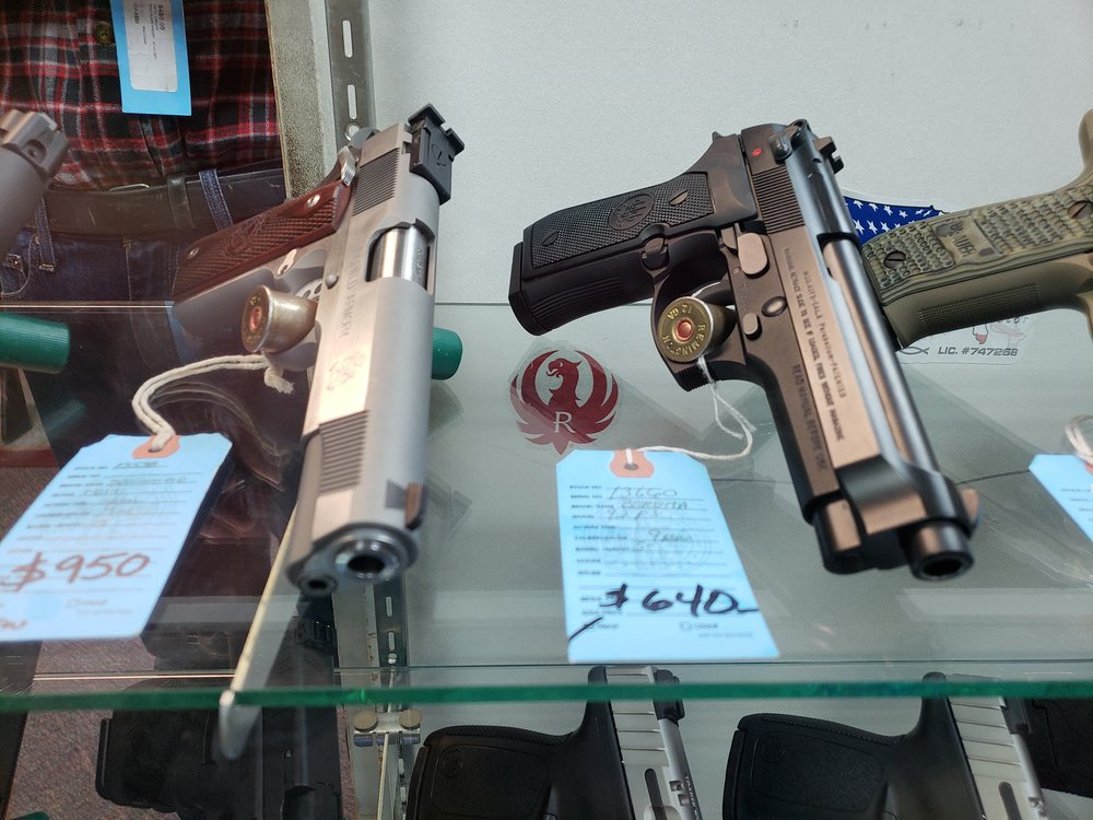 The gun on the left is an M1911 and the one on the right is an M9 Beretta. Both guns are still in military service. Photo by Erick Chairez.