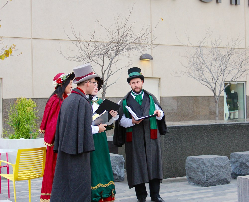 The Charles Dickens Carolers Quartet performs traditional songs around Victoria Gardens. Photo by Paris Barraza