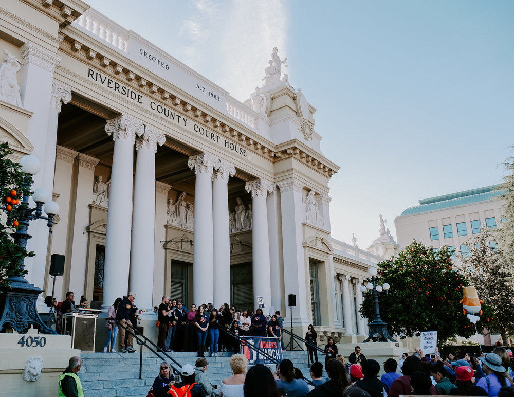 Protestors start to gather in front of the Riverside County Court House to listen to speakers of the event. Roughly 4,000 individuals attended the Women's March in Riverside on Jan. 19, 2019. Photo by Nadine Hale Hautea.