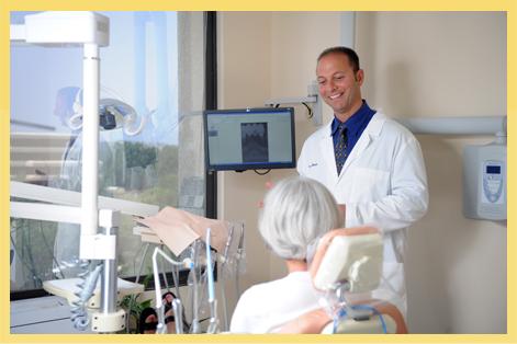 Dr. Louis talks with a patient.