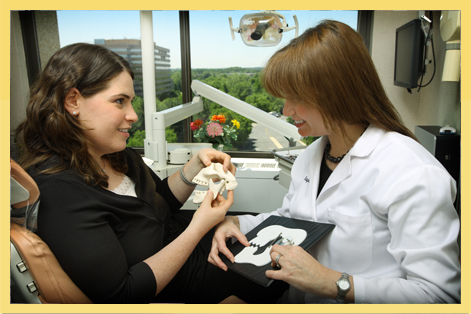 Dr. Sarit Kaplan explains a prosthodontic procedure to her patient.
