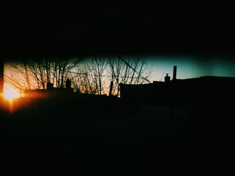 The view of the sun setting in Ridgewood, Queens in New York City.