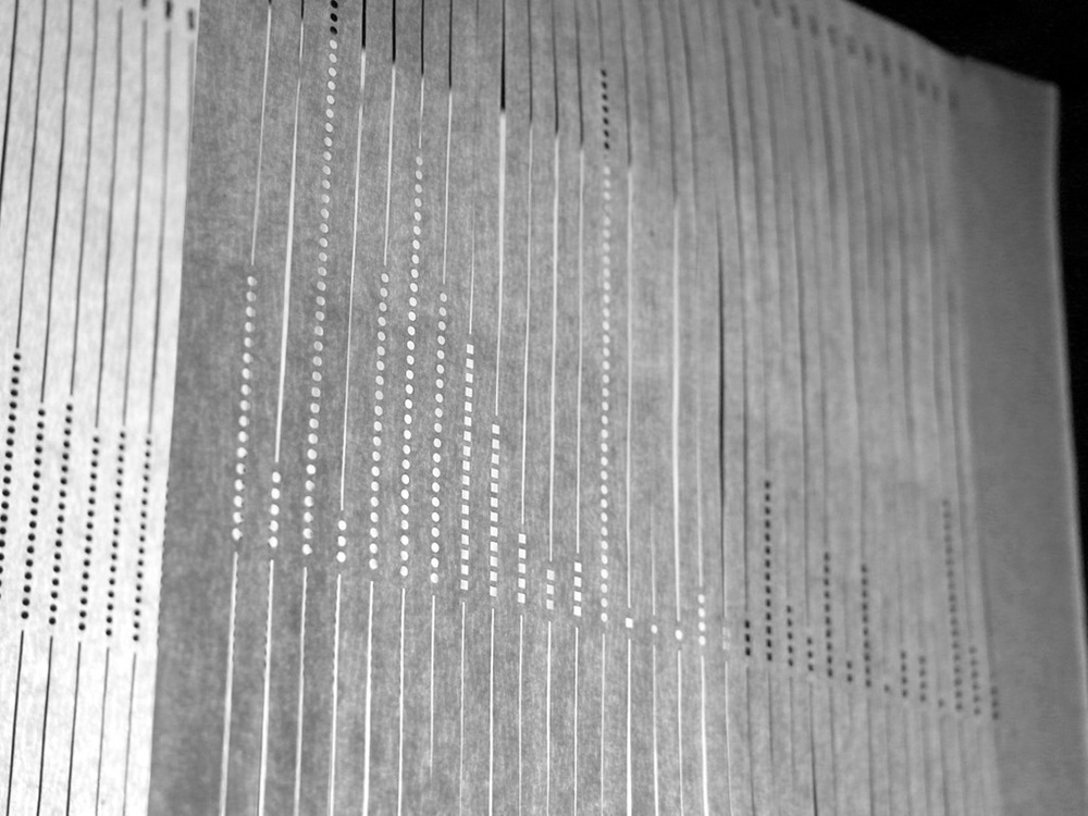 Data as lens was inspired by standardized Scantron sheets and images of aerial crop photography. By layering lasercut sheets of parchment paper with histograms of mean SAT scores and crop yields, values are less clear. The interplay of space and light exposes the layers of meaning beneath numbers.