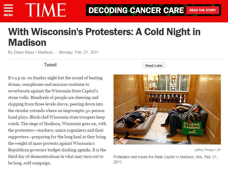 It's 9 p.m. on Sunday night but the sound of beating drums, saxophones and maracas continue to reverberate against the Wisconsin State Capitol's stone walls. Hundreds of people are cheering and clapping from three levels above, peering down into the circular rotunda where an impromptu 50­person band plays. Black­clad Wisconsin state troopers keep watch. The siege of Madison, Wisconsin goes on, with the protesters—teachers, union organizers and their supporters—preparing for the long haul as they bring the weight of mass protests against Wisconsin's Republican governor budget slashing agenda. It is the third day of demonstrations in what may turn out to be long, cold campaign.