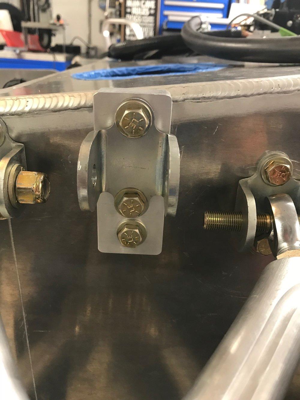 Bracket mounted to spacer