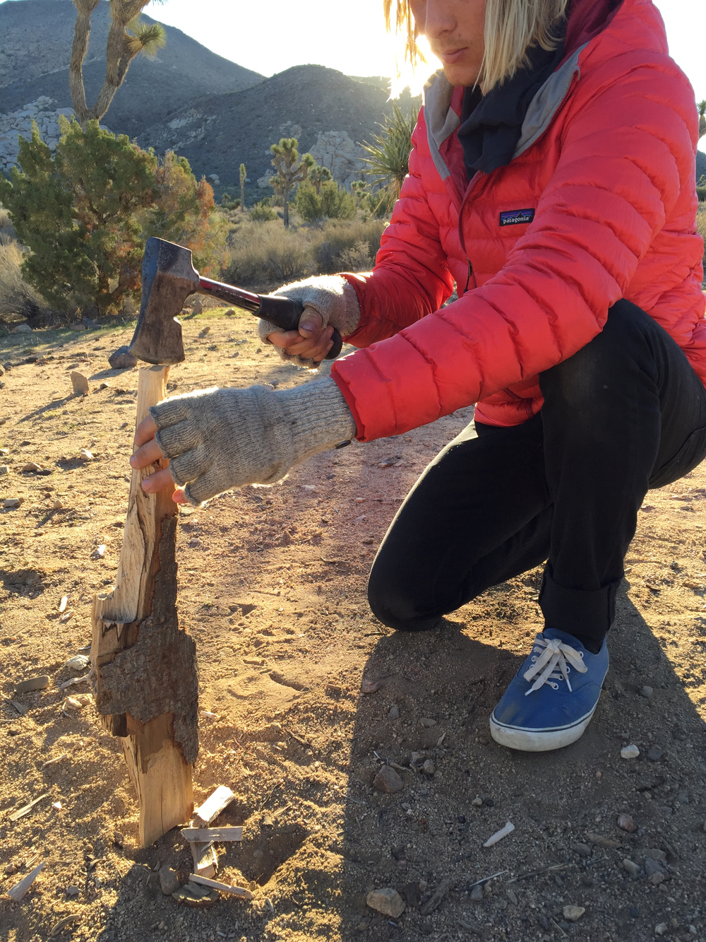 Starting up a fire during a chilly morning in the desert. We woke to find that our water supply we left outside was almost frozen solid.