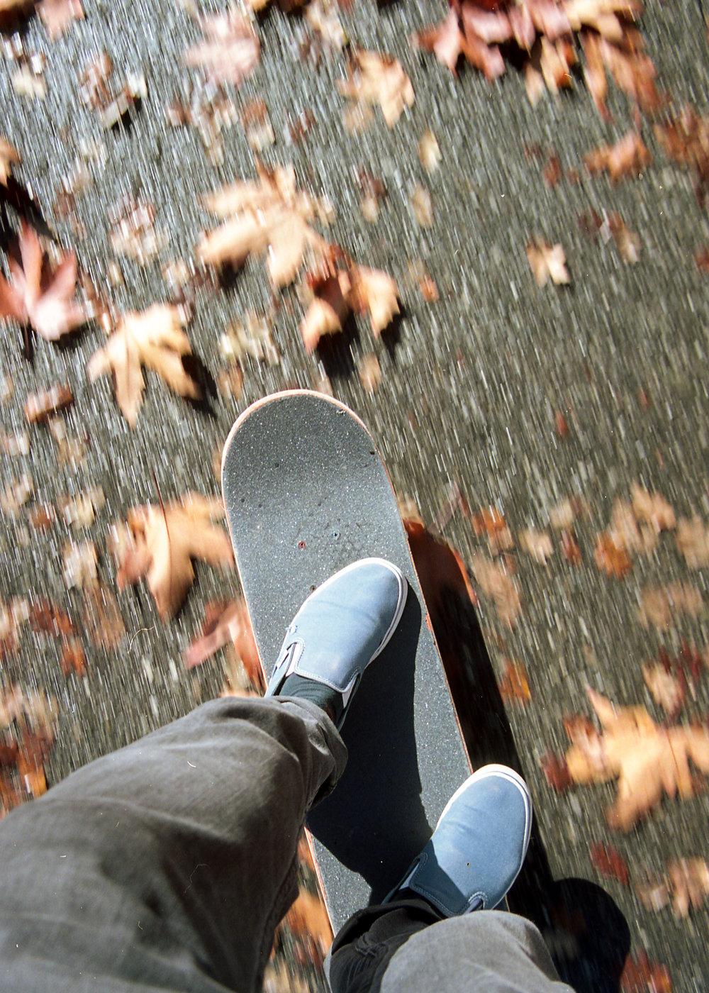 Sidewalk surfing.