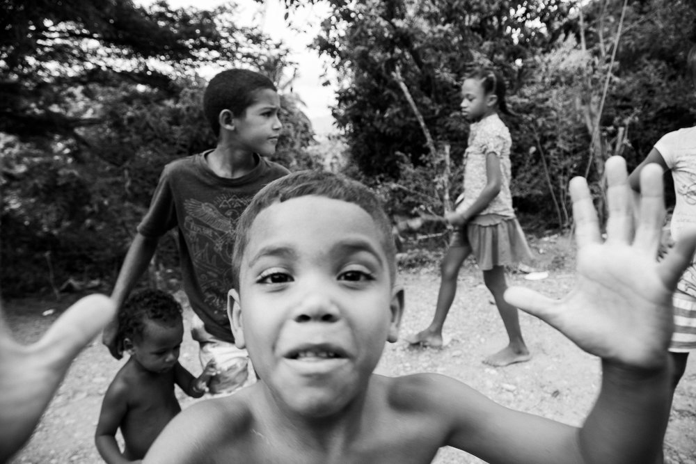 Dominican friends. I was as stoked to meet them as they were to play with my camera.
