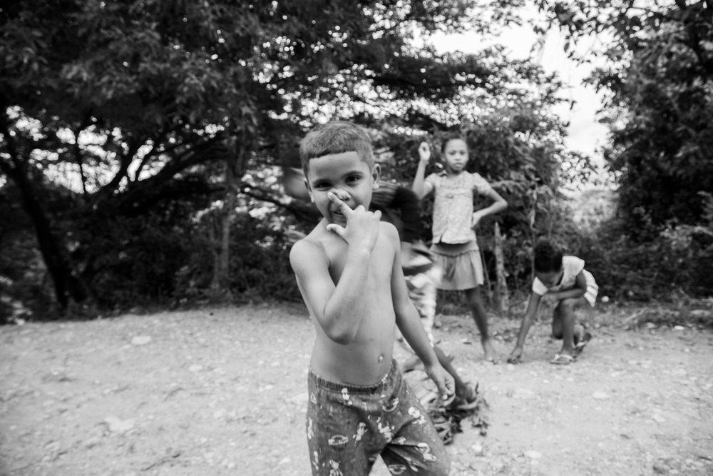 Not only did my first time in a third world country teach me to never travel with just plastic, but this trip was amazing to hang with kids like these. I could teach them how to click a shutter all day long, even if they swarm and fill my lens with finger prints. For more information on how you can help a rad organization in a place like the DR, check out GO Ministries    here.