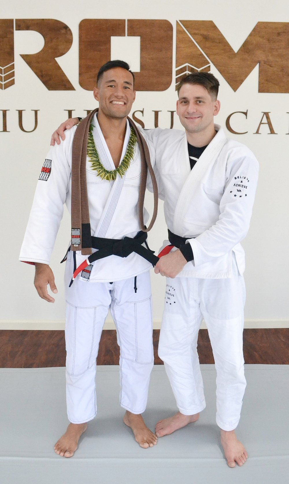 Kawika with Professor Rafael Mendes after receiving his black belt.