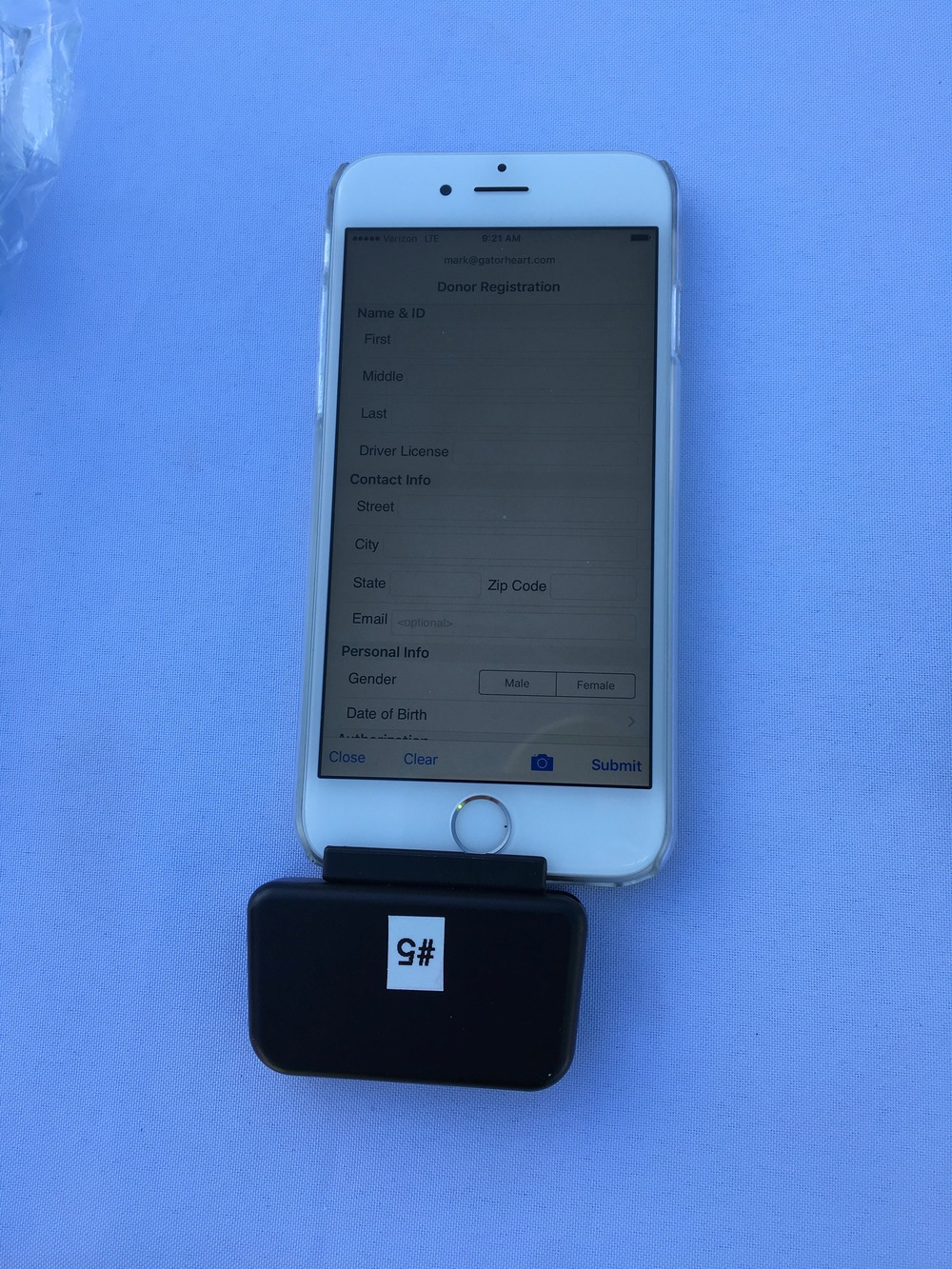 This is an example of the swipe device attached to one of the iPhones provided by the Donor Network. I am logged in to the registration app and when license is swiped, all the fields are filled in and then the person can agree and submit their choice to register - very smooth and easy!