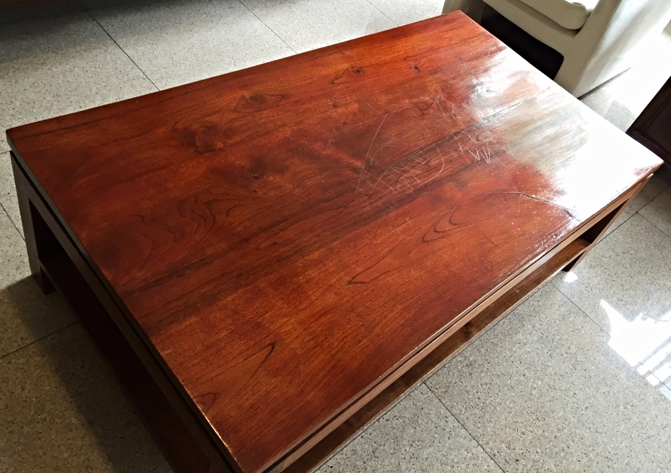 BEFORE: Lacquered teak table hides the natural beauty of the teak wood.